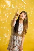 Portrait of young woman wearing spotted dress with glitter Stock Photos