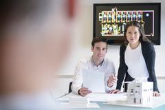 Architects making presentation in boardroom with model building Stock Photos