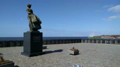 Statue Urker vrouw and memorial wall to lost fishermen on Urk Stock Footage