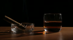 Whiskey drinks with smoking cigars - stock footage