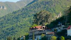 Sunrise in the mountain village in Gagra, Abkhazia, panorama Stock Footage