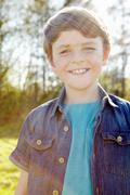 Boy with toothy smile - stock photo