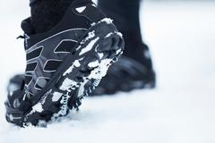 Underside of snow running shoes - stock photo