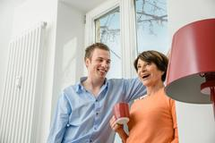 Woman and grown up son talking Stock Photos