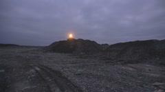 Bulldozer going along piles of  soil Stock Footage
