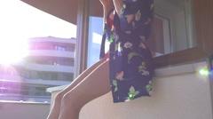 Girl wearing underwearing drinking coffee on the terrace. 50 fps Stock Footage