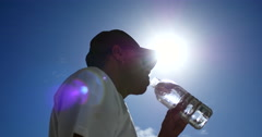 Man drinking clear water Stock Footage