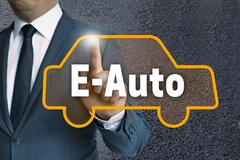 e auto touchscreen is operated by businessman concept - stock photo