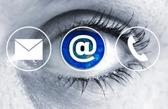 Contact Options eye looks at viewer concept - stock photo