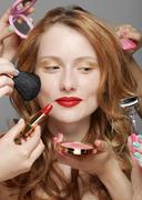 Young woman with make-up artists Stock Photos