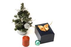 Christmas tree, candle, sphere and gift - stock photo