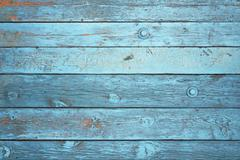 Background of blue boards with peeling paint. Stock Photos