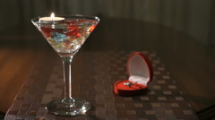 Burning candle in glass with precious stones Stock Footage