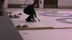Senior citizens - retired men curling in rink - stock footage