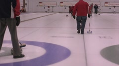Senior citizens - retired men curling in rink Stock Footage
