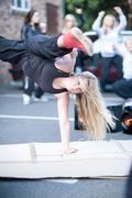 Girl breakdancing in carpark - stock photo
