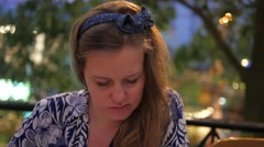 Lovely young woman reading menu in cafe Stock Footage