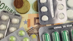 Euro money bills and colorful pills Stock Footage