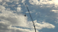 A tower for bungee jumping raises the cabin with people. Arkistovideo