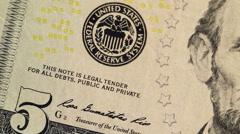 Dollar bill macro rotating. Five dollar bills, close up, rotate. Macro Stock Footage