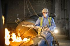Portrait of furnace repair worker in protective clothing in steel foundry Stock Photos