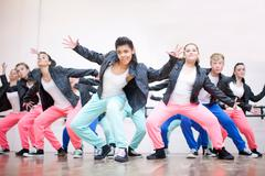 Large group of teenagers dancing in studio Stock Photos