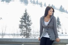 Candid portrait of young female in front of ski hill - stock photo