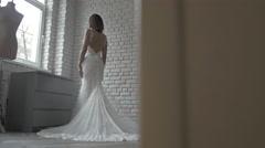 Beautiful Bride Fashion Model in Long white Wedding Dress in Shop - stock footage