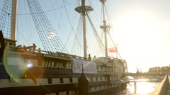 View of the frigate grace at the summer sunset in slowmotion Stock Footage