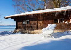 Snow covered log cabin, Lake Starnberg, Bavaria, Germany Stock Photos