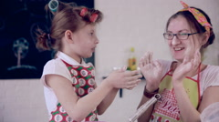 Mom baking with daughter in kitchen Stock Footage