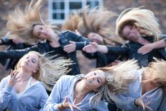Girls practicing dance in carpark - stock photo