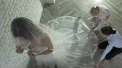 Women Making Adjustment to Wedding Gown in Professional Fashion Designer Studio - stock footage