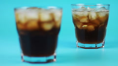 glass of cola on a blue background - stock footage