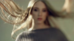 Sensual woman with long straight hair on a photo shoot Stock Footage