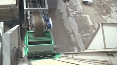 Sand, soil falling on conveyor - stock footage