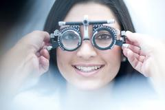 Young female having her eyes examined Stock Photos
