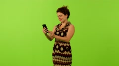 woman texting smartphone greenscreen ms 4K - stock footage