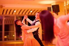 Young ballroom dancers practising in mirror Stock Photos