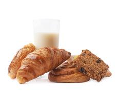 Glass of milk and pastry Stock Photos