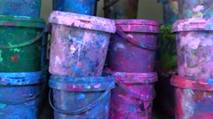 Industrial multicolor paint buckets storage 4K dolly shot, close up version Stock Footage