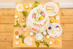 Table with assortment of cakes and confectionery - stock photo