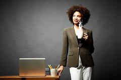 Woman holding cup of steaming hot beverage - stock photo