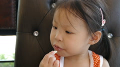 Girl eating white chocolate Stock Footage