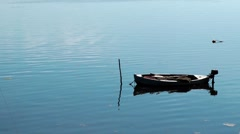 Lonely boat on a lake Stock Footage