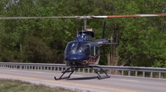 Air Evac Helicopter Taking Off on Roadway Stock Footage