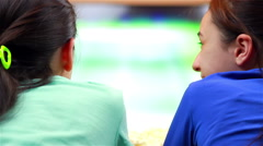 Happy teenage girls watching tennis sport on smart tv Stock Footage