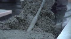 Pouring and Mixing Wet Concrete Stock Footage