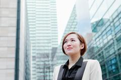 Close up of business woman looking into distance Stock Photos