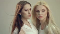 Two beautiful models at a joint photo shoot - stock footage